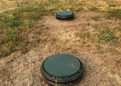 Septic tank lid risers in park